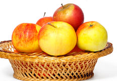 Many apples in a straw basket Stock Photos