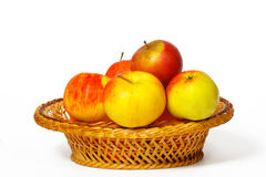Many apples in a straw basket Royalty Free Stock Photography