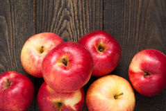 Many apples on the table. Some red apples on the dark wooden table royalty free stock photography