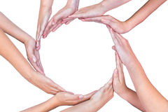Many arms of children with hands making circle Stock Images