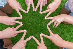 Many arms of children with hands making star Royalty Free Stock Images