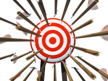 Many arrows flying towards the goal. On white background Stock Photo