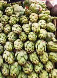 Many artichokes on a market stall Stock Photography