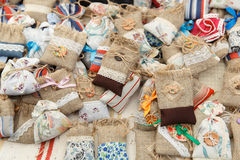 Many assorted colorful gift Pouches on fair Stock Image