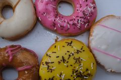 Fresh donuts with colorful glaze in the box royalty free stock photography