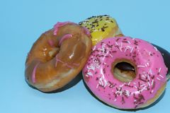 Assorted donuts on a blue background. Many Assorted donuts on a blue background stock photos