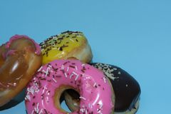 Assorted donuts on a blue background. Many Assorted donuts on a blue background stock images
