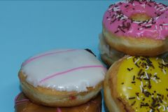 Assorted donuts on a blue background. Many Assorted donuts on a blue background stock image
