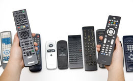 Free Many Assorted Remote Controls In Hands Royalty Free Stock Photo - 7593675