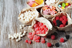 Candies. Many assorted sweet sugar candies on vintage wooden background Stock Image