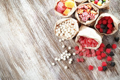 Candies. Many assorted sweet sugar candies on vintage wooden background Royalty Free Stock Photography