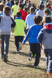 Many athletic children running on a sunny day. Outdoor circuit Stock Images