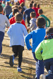 Many athletic children running on a sunny day. Outdoor circuit. Vertical Royalty Free Stock Image