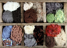Many autumn colored yarns in wooden box Stock Images