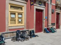 Many backpacks on the ground in front of a backpacker hostel royalty free stock photography