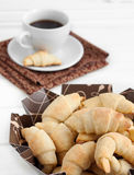 Bagels with coffee. Many bagels with cup of coffee royalty free stock images