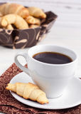 Coffee with bagels. Many bagels with cup of coffee royalty free stock images
