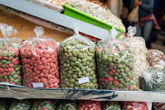 Many bags of various types of nuts for sale in a plastic bag Stock Photos