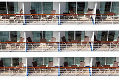 Many balconies with chairs table on ship. Front Royalty Free Stock Photography