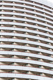 Many Balconies on Curved Glass Hotel Royalty Free Stock Photos