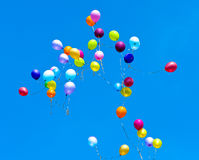 Many balloons fly into the sky Stock Images