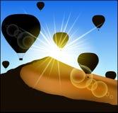 Many balloons flying up over the desert. Stock Photo