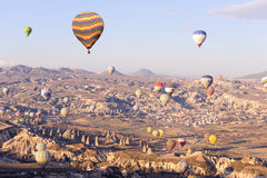 Many balloons over the extraordinary rocks formations rock hills of mushroom valley, pasabagl Stock Images