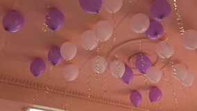 Many balloons under ceiling stock footage
