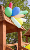 Many balloons on wooden summerhouse Royalty Free Stock Photos