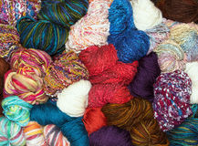 Many balls of muted natural wool Stock Photos
