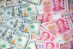 The many banknote. money hundred dollars bills. Pile of various currencies isolated on yuan background.Closeup of assorted American banknotes. war of currency Stock Photo