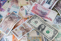 Many banknotes of different countries. Scattered on the table Stock Images