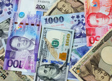 Many banknotes of different countries Royalty Free Stock Images