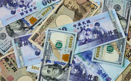 Many banknotes of different countries Royalty Free Stock Photography