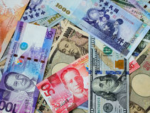 Many banknotes of different countries Stock Photography