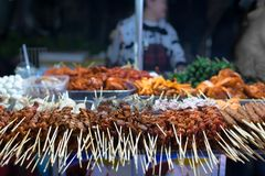 Many bbq skewers lined up and ready to be grilled for hungry customers. Street food in Asia, grilled bbq skewers at a food stand. Vietnam Stock Photography