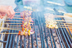 Many bbq sticks on grill, outdoor, bbq time Royalty Free Stock Images