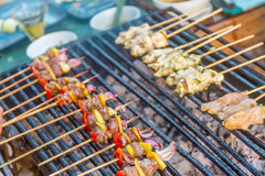 Many bbq sticks on grill, outdoor, bbq time Stock Photography