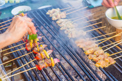 Many bbq sticks on grill, outdoor, bbq time Stock Image