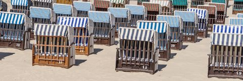 Many beach chairs on a sunny day at the Baltic Sea Stock Image