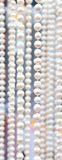 Many beads of pearls as ackground. Stock Photography