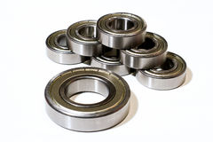 Many bearings of different sizes together. White background Stock Photography