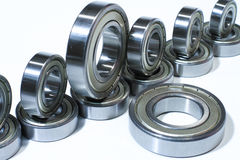 Many bearings of different sizes together. White background Royalty Free Stock Photos