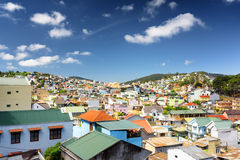 Many beautiful colorful houses of Da Lat city (Dalat) on the blu Stock Images