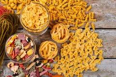 Many beautiful Italian pasta on the old background. Still life with italian pasta Stock Photo