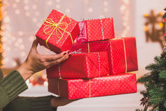 Many beautiful present in red wrapping paper Stock Photos