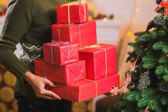 Many beautiful present in red wrapping paper Royalty Free Stock Photo