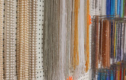 Many beautiful shimmering necklaces made with pearls and colorfu Royalty Free Stock Photography