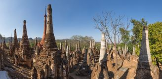 Pagodas at Indein Village. Many beautiful stone stupas hidden in a remote area of Myanmar across lake Inle neart the village of Indein. Panoramic picture Royalty Free Stock Images