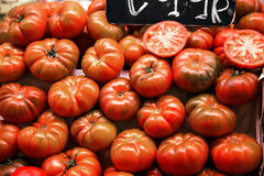 Many beefsteak tomatoes on a market stall Stock Photo